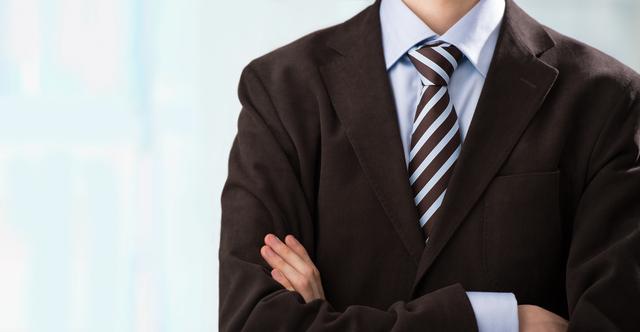 Closeup of torso of confident business man wearing elegant suit