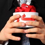 Businessman with gift box in hands